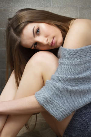 Portrait of an elegant serene woman in woollen sweater photo