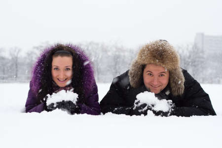 Portrait of young couple having fun in winter park photo