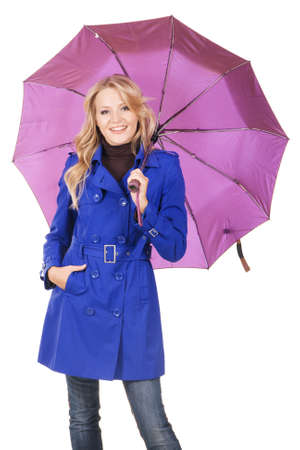 denim jacket: Lovely woman in blue coat with umbrella against white background  Stock Photo
