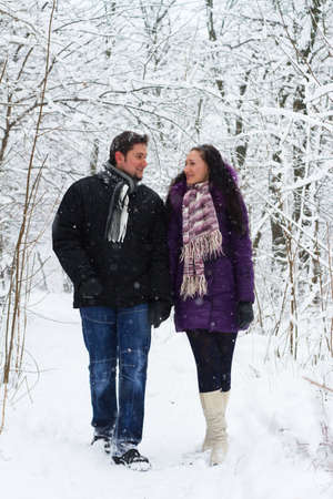 Young happy couple walking in winter park  photo