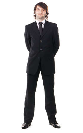 Elegant man in black suit against white background  Stock Photo