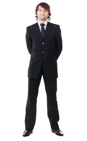 persona de pie: Hombre elegante traje negro sobre fondo blanco