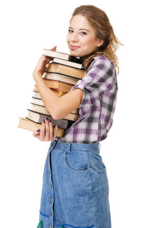Lovely girl with stack of books, white background  photo