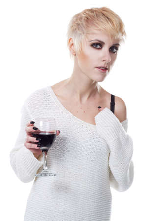 Portrait of a beautiful woman with glass of wine against white background photo