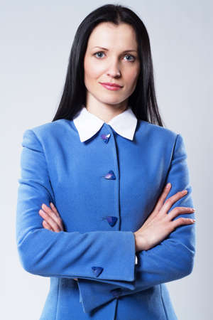 Portrait of beautiful confident businesswoman in blue suit photo