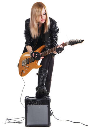 guitar amplifier: Teenage girl playing electric guitar, white background