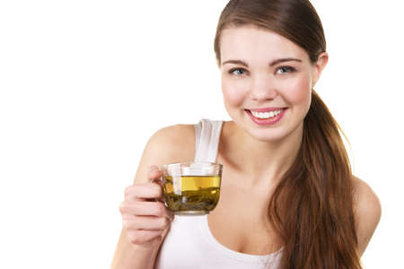 Young beautiful woman with a cup of green tea, white background photo
