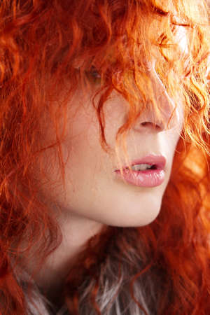Closeup portrait of a beautiful red-haired woman photo