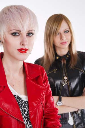 Portrait of two stylish teenage girls photo