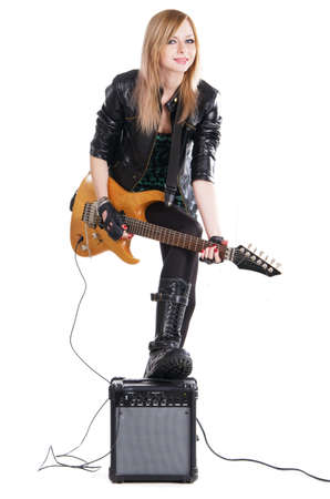 Teenage girl playing electric guitar against white background  photo