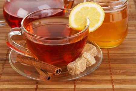 Tea with honey, lemon and cinnamon photo