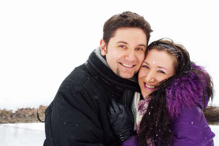 Young happy couple having fun in winter park  photo