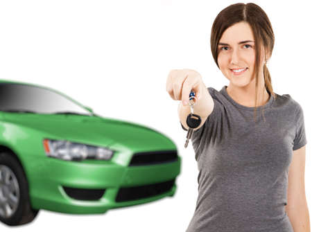 Young woman with car keys and new auto on white background photo