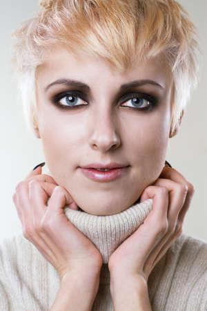 Closeup portrait of a young stylish blonde  photo