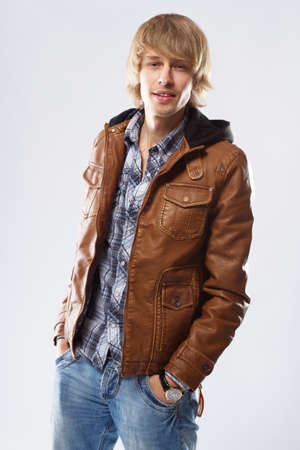 Handsome young man in leather jacket, studio portrait photo