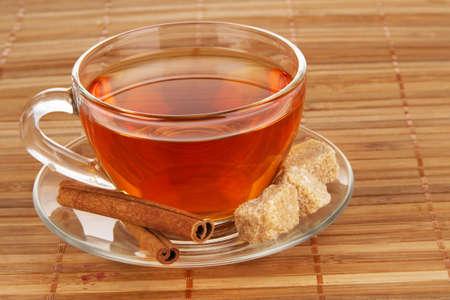 Tea with honey, lemon and cinnamon on bamboo pad photo