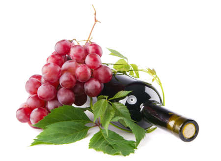 green bottle: Bottle of red wine with grapes, white background