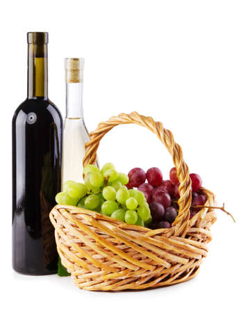 Bottles of red and white wine with grapes, white background photo
