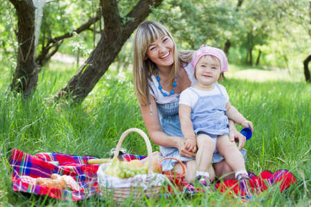 Cheerful mother with her daughter outdoor portrait photo
