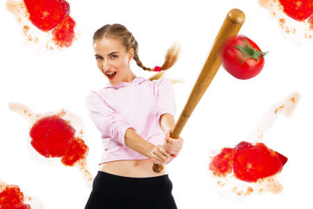 Lady beating off tomatoes with a baseball bat, white background Stock Photo - 9987458