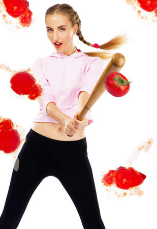 Lady beating off tomatoes with a baseball bat, white background Stock Photo - 9987466