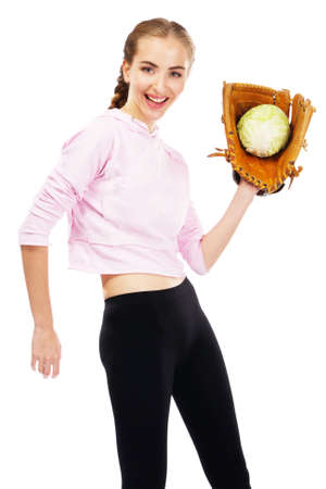 Young woman holding a cabbage in baseball glove photo
