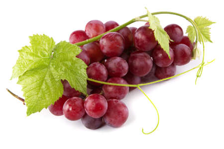Red grapes with fresh leaves, isolated on white background