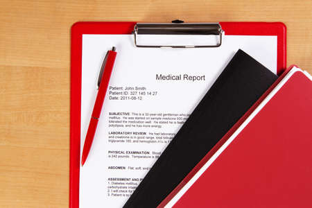 Medical report on a red holder photo