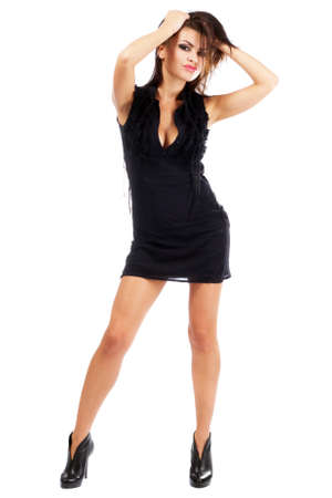 Sexy young woman in black dress, isolated on white background Stock Photo - 10699692