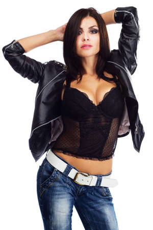 Sexy young woman in leather jacket, studio portrait photo