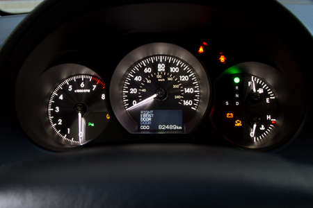 Illuminated sports car dashboard closeup photo photo