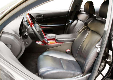 Interior of a luxury car with leather seats photo
