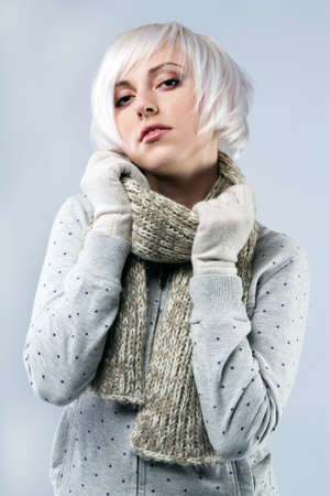 girl short hair: Beautiful lady in warm clothes, studio portrait
