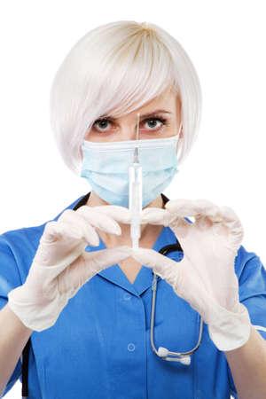Friendly nurse on white background, studio portrait photo