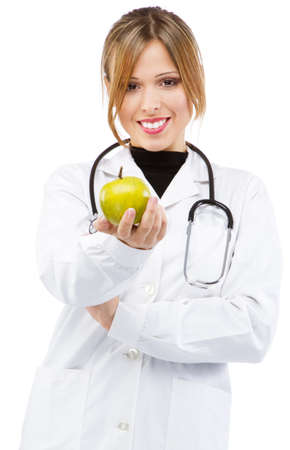 Pretty nurse offering an apple photo