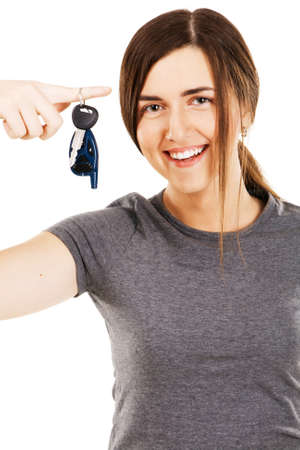 Young beautiful woman holding car keys on her finger photo