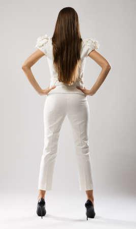Fashion model in stylish dress, studio portrait photo