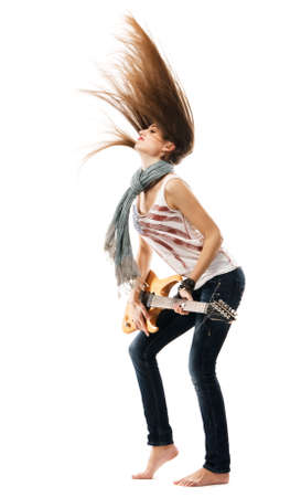 Wild girl playing electric guitar, white background photo