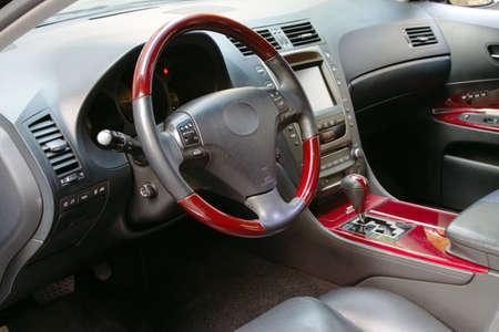 Interior of a luxury car with mahogany finish photo