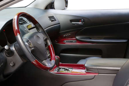 Interior of a luxury car with mahogany finish photo