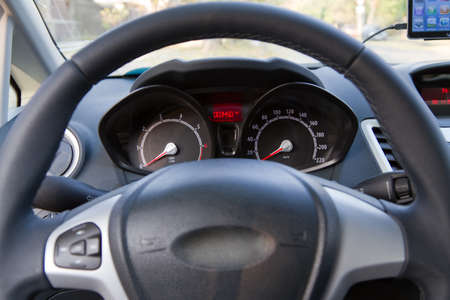 Interior of a modern car, steering wheel and dashboard photo