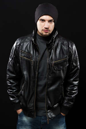 leather jacket: Handsome young man in black leather jacket, studio portrait