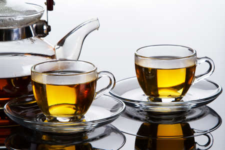 Tea cups and a teapot photo