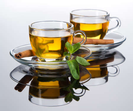 herbal tea: Tea cup with fresh mint leaves, closeup picture