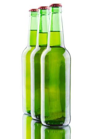 Beer bottles isolated on white background, studio still-life photo