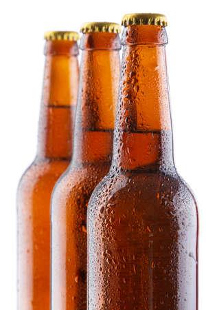 alcohol bottles: Beer bottles isolated on white background, studio still-life Stock Photo