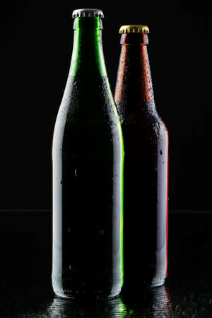 Two beer bottles silhouette, studio photo photo