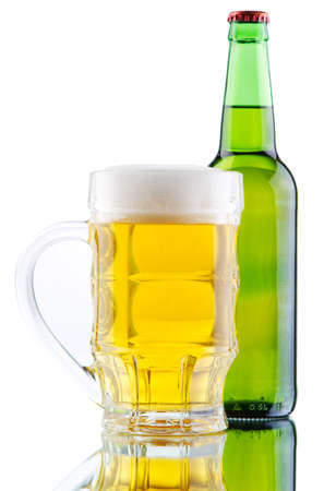 Beer mug and bottle isolated on white background photo