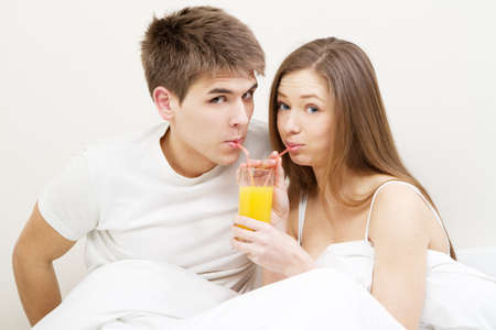 Young couple drinking juice in the morning Stock Photo - 12980493