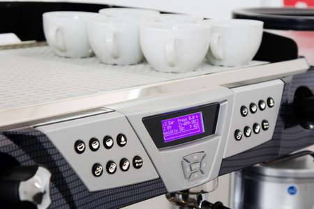 Professional coffee machine closeup with selective focus photo
